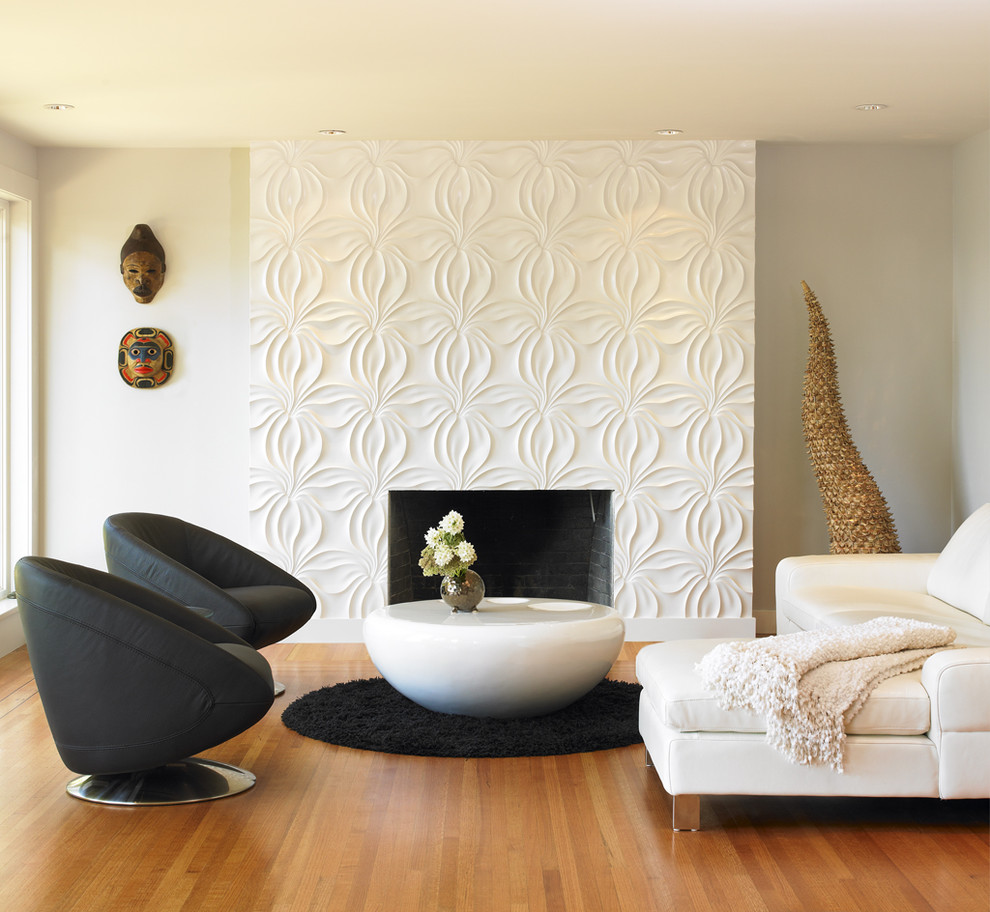 Example of a minimalist living room design in Vancouver with white walls and a standard fireplace