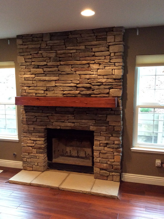 A Rustic Hand Hewn Mantel - This beam was purchased through an F.S.C.