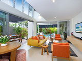 contemporary living room Houzz Tour: Indoor Outdoor Connections in a Renovated Noosa Duplex (17 photos)