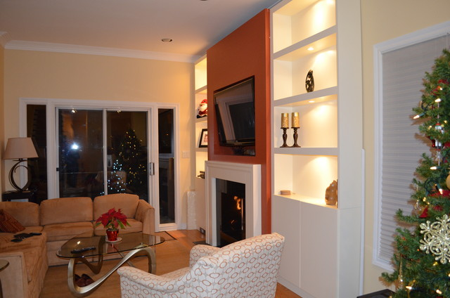 A whole wall unit and refaced fireplace Contemporary