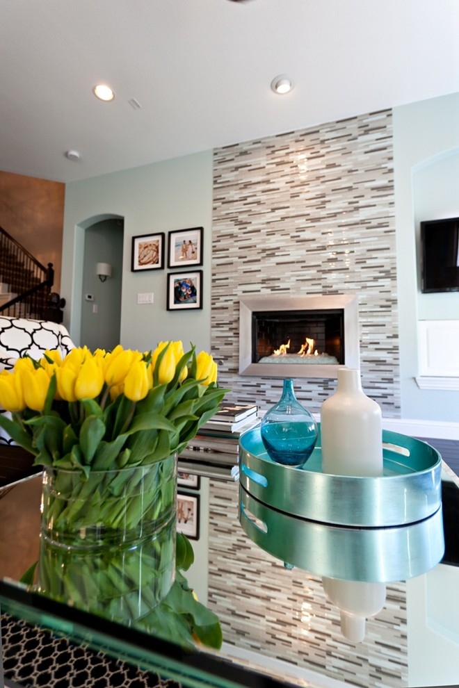 Inspiration for a contemporary living room remodel in Dallas with a metal fireplace