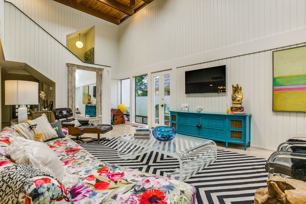Inspiration for a large eclectic open concept light wood floor living room remodel in Dallas with white walls and a wall-mounted tv