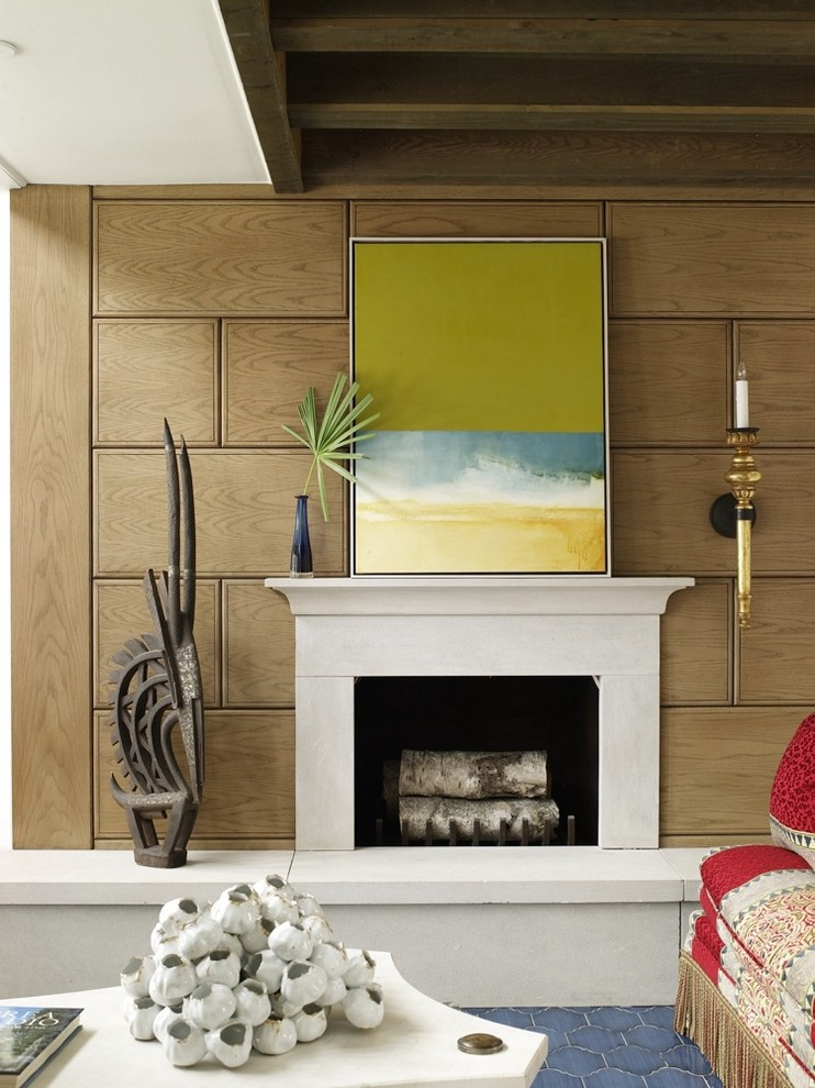 Inspiration for a tropical blue floor living room remodel in Miami with a standard fireplace