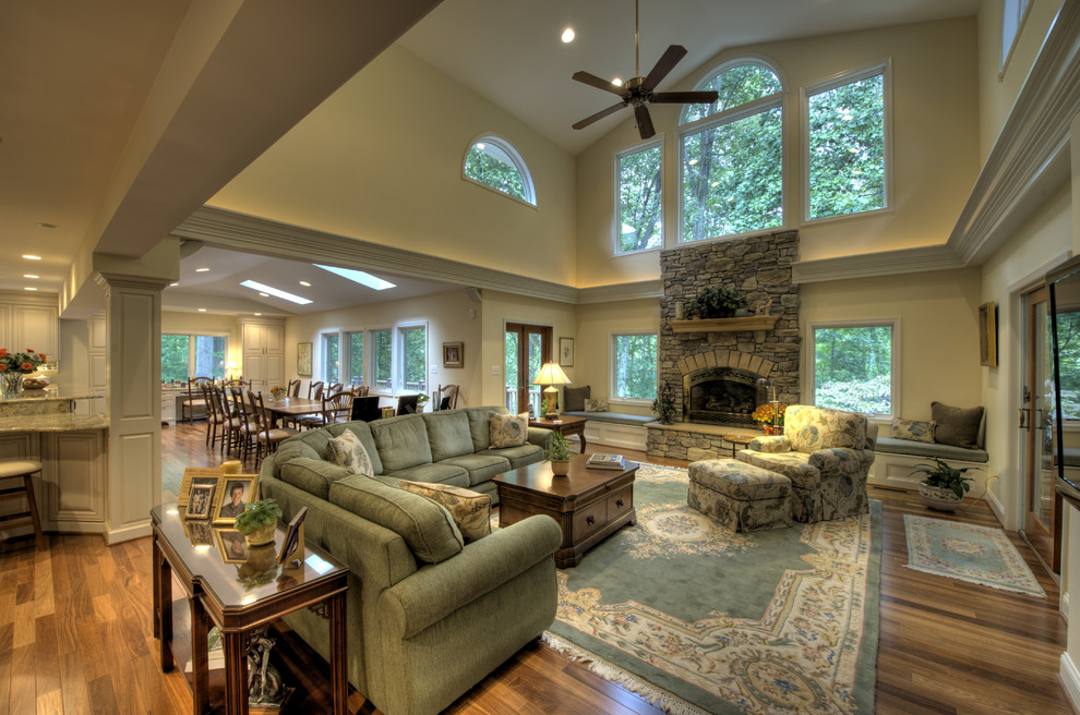 Living room - traditional living room idea in DC Metro with a stone fireplace