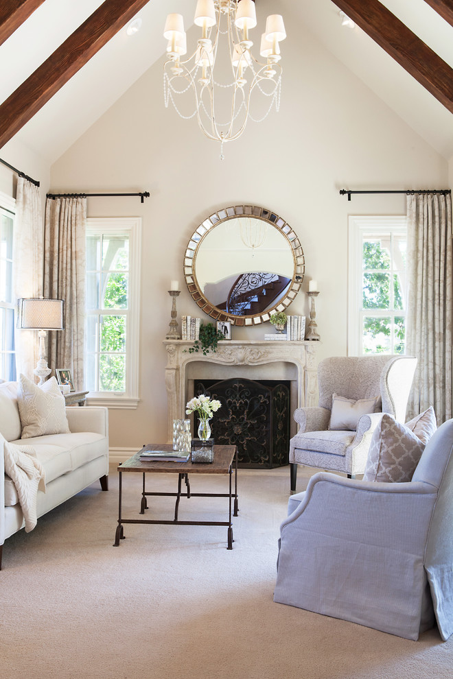 Large transitional formal and enclosed carpeted and beige floor living room photo in Orange County with beige walls, a standard fireplace, a stone fireplace and no tv