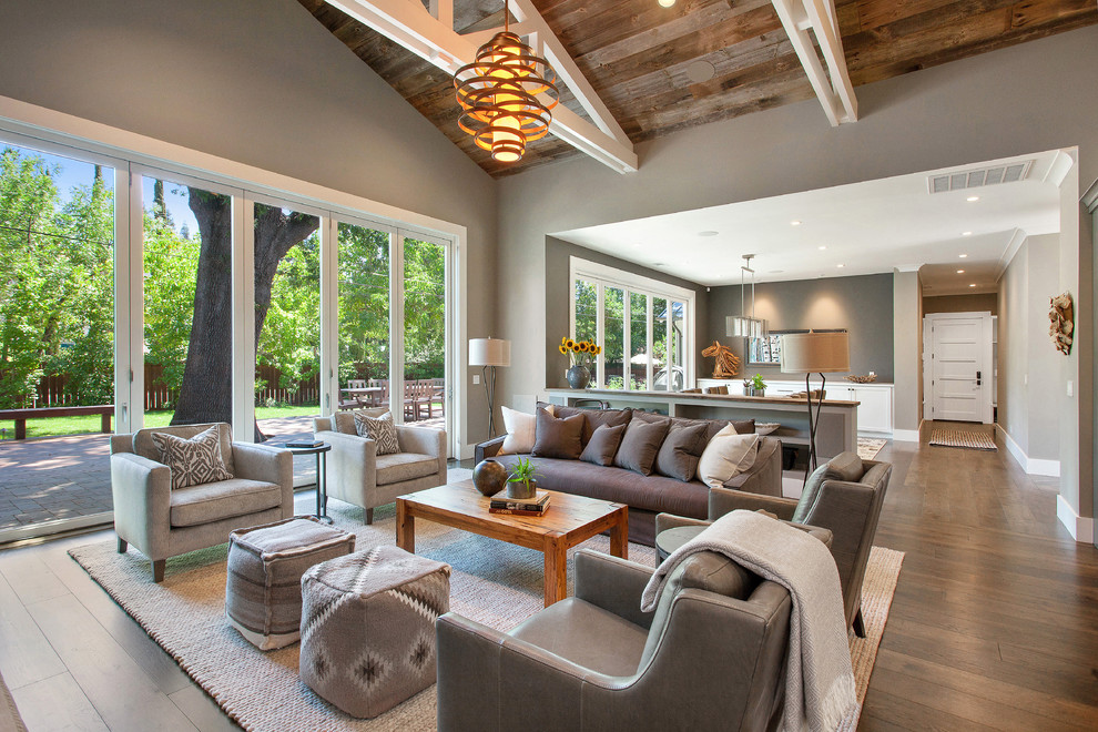Living room - mid-sized country open concept medium tone wood floor living room idea in San Francisco with gray walls