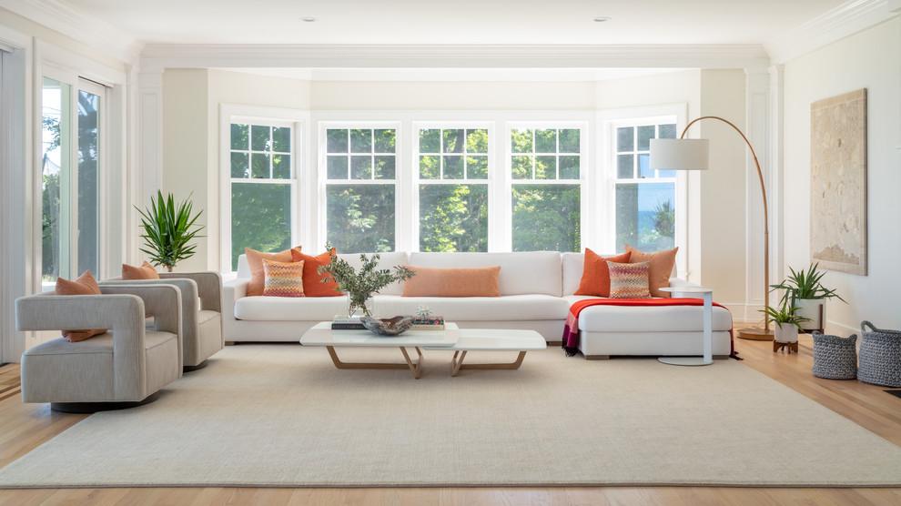 Design ideas for a scandinavian living room in New York with white walls, light hardwood floors and beige floor.