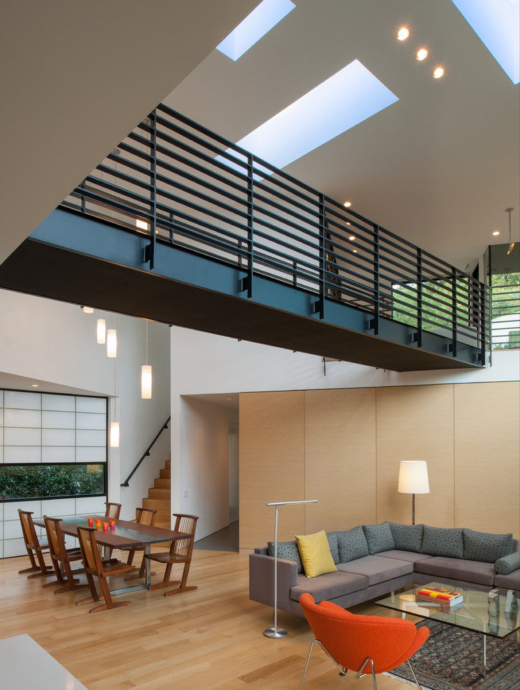 Inspiration for a contemporary light wood floor living room remodel in DC Metro with white walls