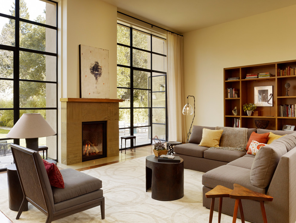 Inspiration for a modern living room remodel in San Francisco with beige walls and a standard fireplace