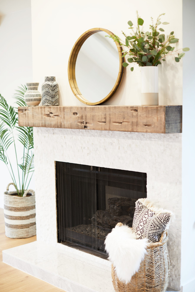 Inspiration for a large country open concept and formal light wood floor and beige floor living room remodel in San Diego with white walls, a standard fireplace and a tile fireplace