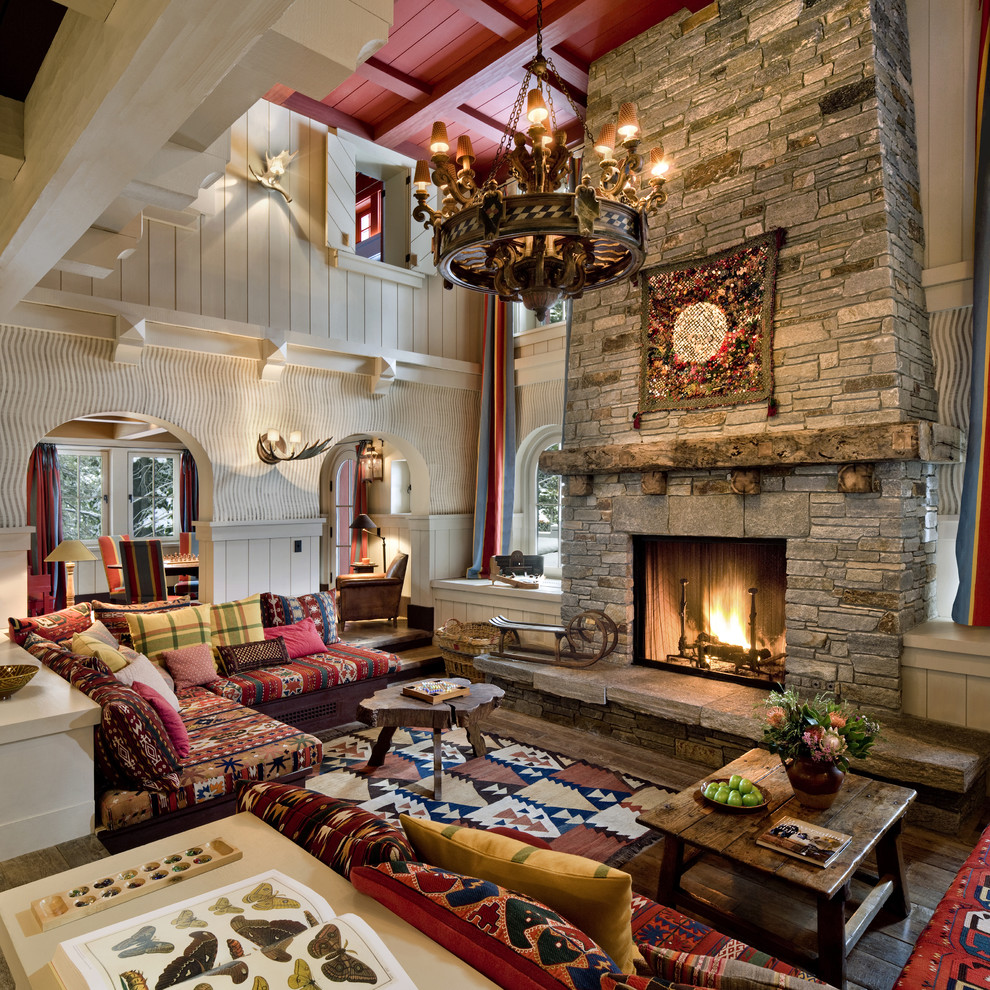 Large mountain style formal and enclosed dark wood floor and brown floor living room photo in San Francisco with a standard fireplace, a stone fireplace, gray walls and no tv
