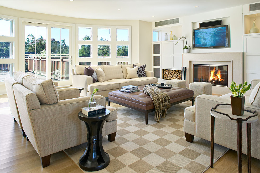 Inspiration for a large coastal living room remodel in New York with a standard fireplace and a media wall
