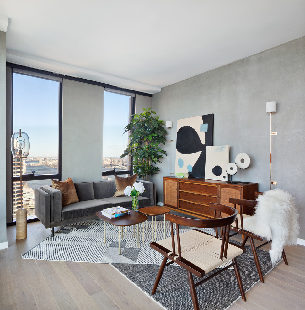 Living room - scandinavian formal light wood floor living room idea in New York with gray walls, no fireplace and no tv