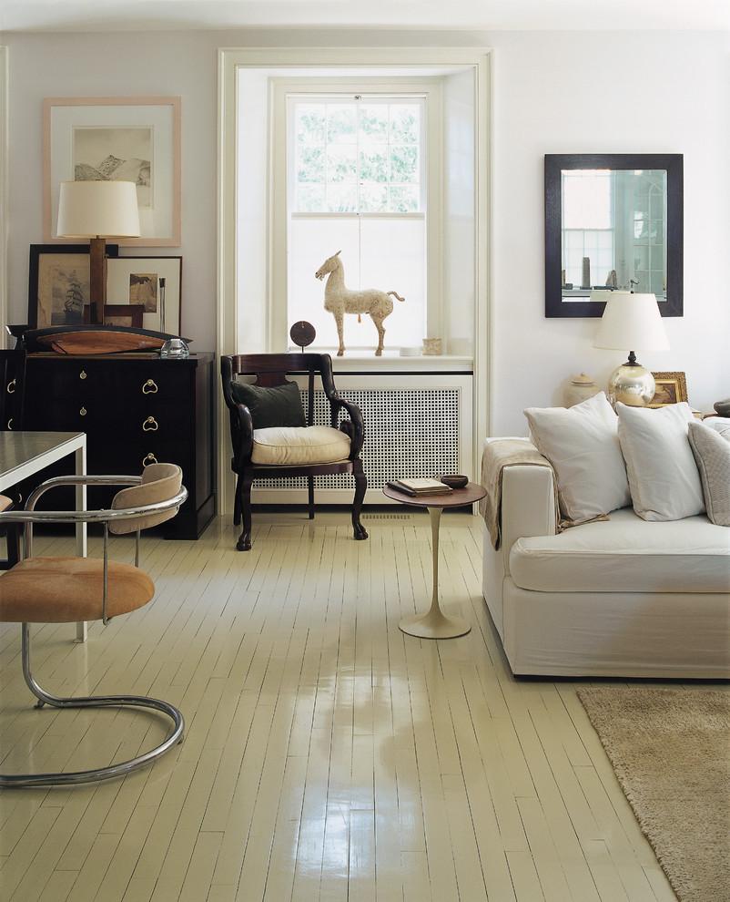 Elegant painted wood floor and white floor living room photo in New York