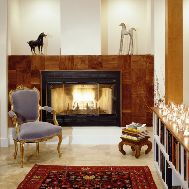 Cozy Contemporary Living Room: An Oriental Rug And A Wood Paneled Fireplace Add A Cozy