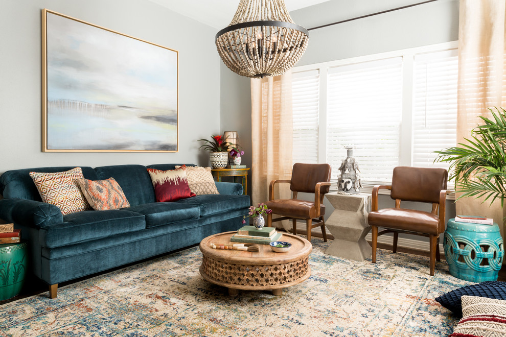 Example of an eclectic formal living room design in Dallas with gray walls and no fireplace