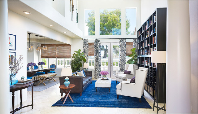 Example of a trendy open concept living room library design in Las Vegas with white walls