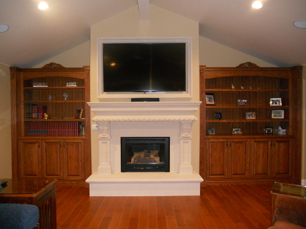 Inspiration for a small timeless formal and enclosed dark wood floor and brown floor living room remodel in San Francisco with beige walls, a standard fireplace, a plaster fireplace and a wall-mounted tv
