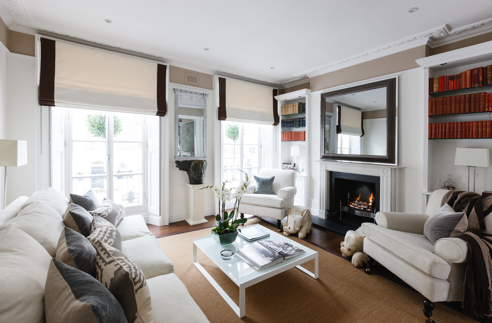 Inspiration for a timeless living room remodel in London with brown walls and a standard fireplace