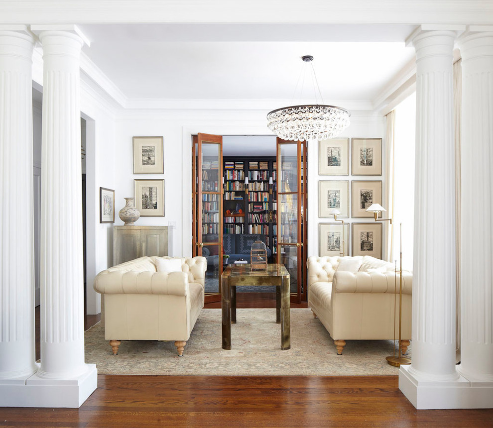 Inspiration for a small eclectic enclosed dark wood floor living room remodel in New York with white walls and no tv