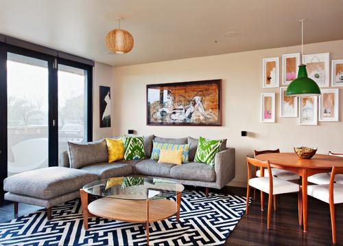 Touche contemporaine dans ce salon grâce au tapis noir et blanc à motifs ultra graphique