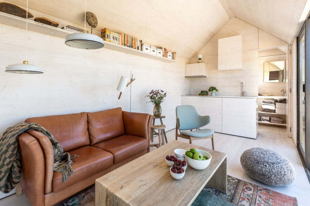 Inspiration for a small scandinavian formal light wood floor living room remodel in Madrid with beige walls, no fireplace and no tv