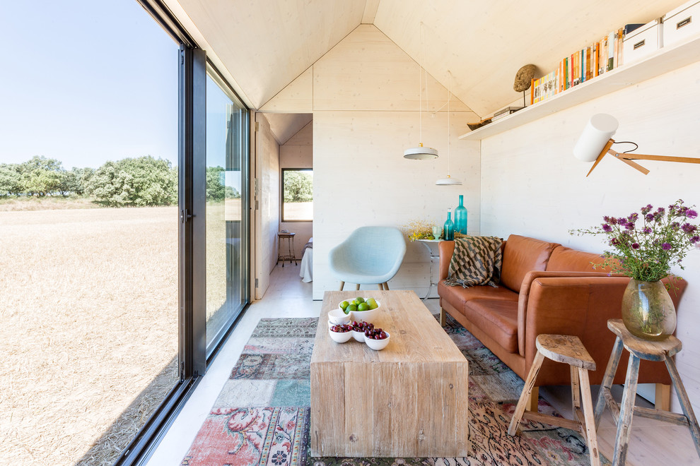 Small eclectic enclosed light wood floor living room photo in Madrid with beige walls, no fireplace and no tv