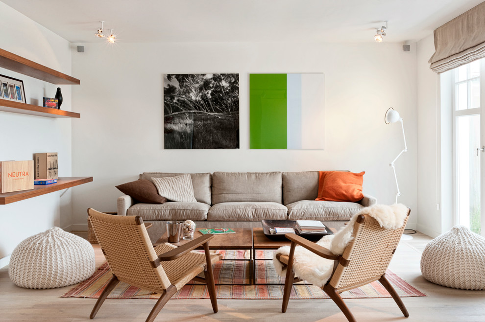 Inspiration for a scandinavian light wood floor living room remodel in Other with white walls, no fireplace and no tv