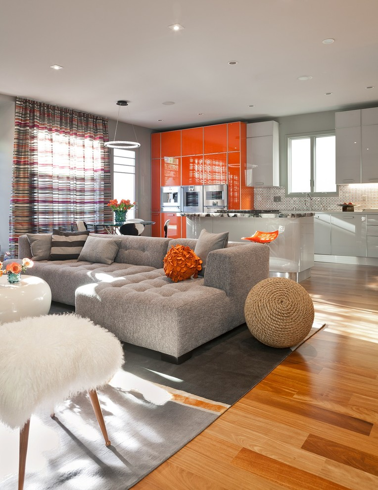 Trendy formal and open concept medium tone wood floor living room photo in San Francisco with gray walls