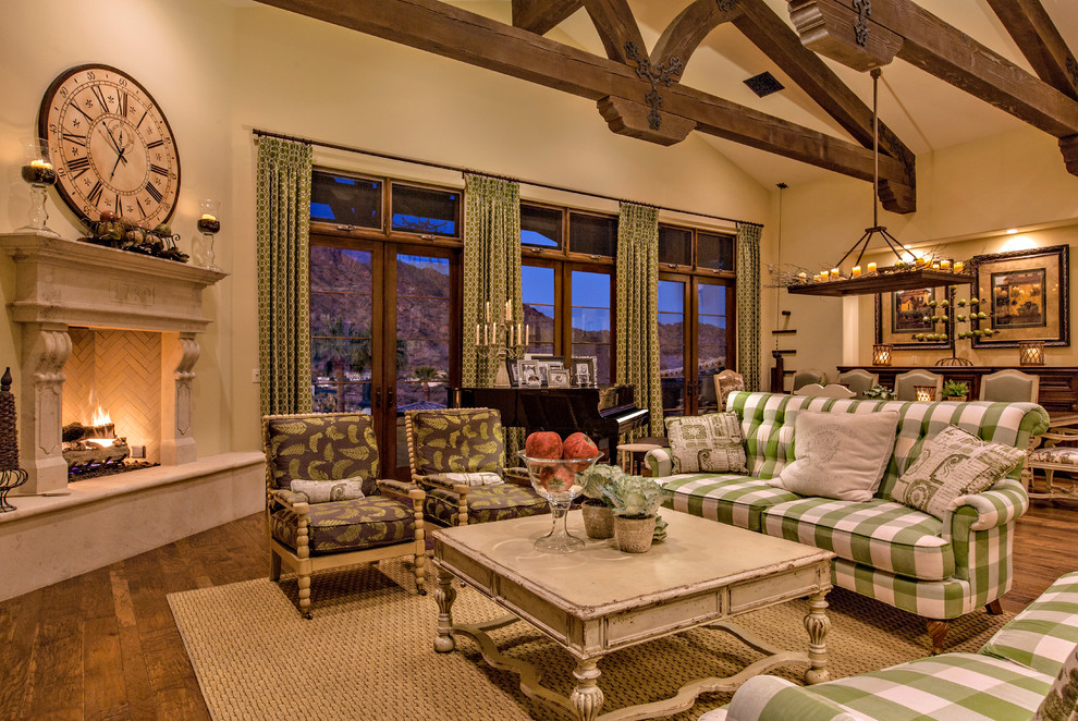 Living room - large french country formal and open concept medium tone wood floor living room idea in Phoenix with beige walls, a corner fireplace, no tv and a stone fireplace