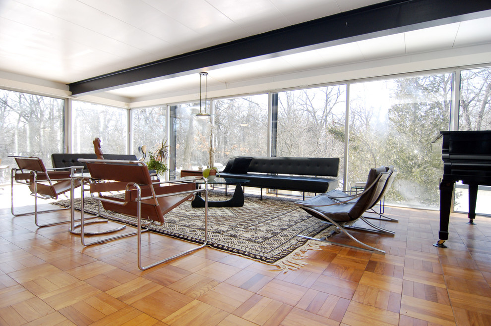 Inspiration for a modern medium tone wood floor living room remodel in Other with a music area