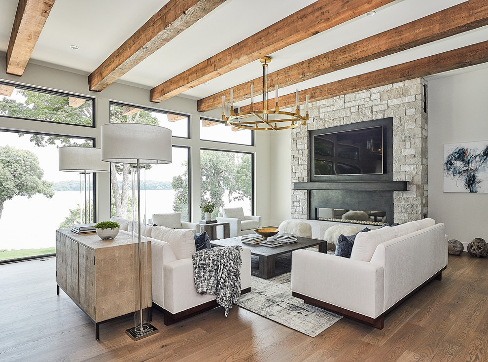 Example of a trendy open concept dark wood floor and brown floor living room design in Minneapolis with a stone fireplace, gray walls, a ribbon fireplace and a wall-mounted tv