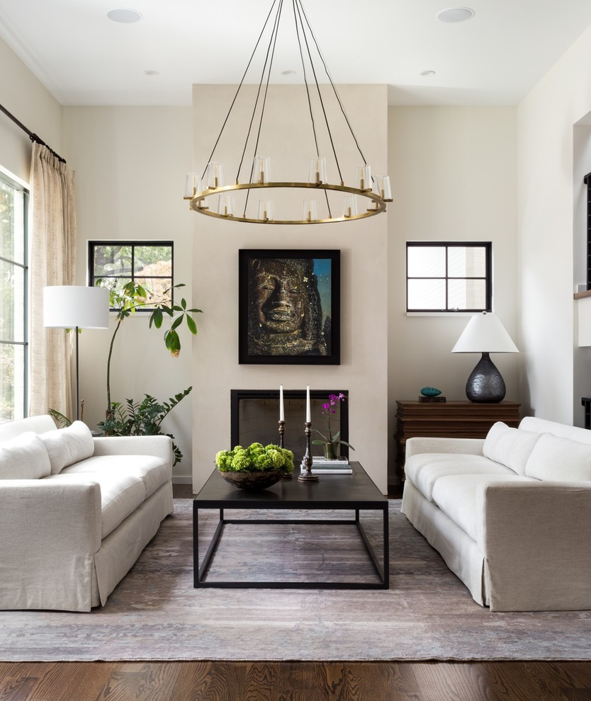 Inspiration for a transitional dark wood floor and brown floor living room remodel in DC Metro with beige walls and a standard fireplace