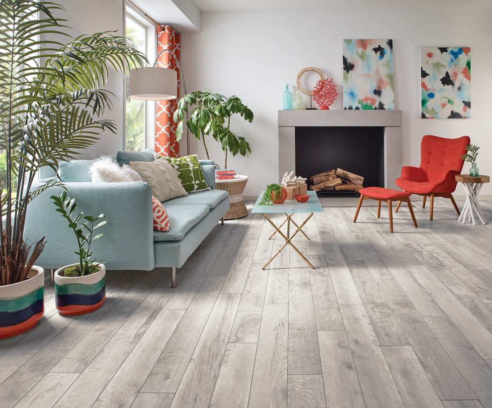 Inspiration for a mid-sized contemporary open concept vinyl floor and beige floor living room remodel in Other with white walls, a standard fireplace and no tv