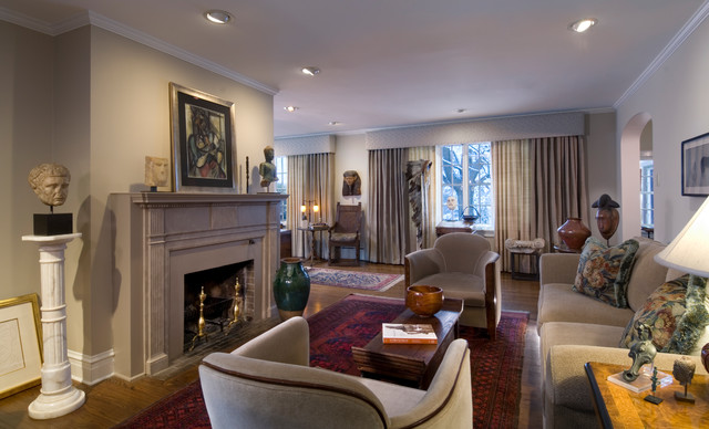 Inspiration for a mid-sized timeless formal and open concept dark wood floor and brown floor living room remodel in Chicago with beige walls, a standard fireplace, a stone fireplace and no tv