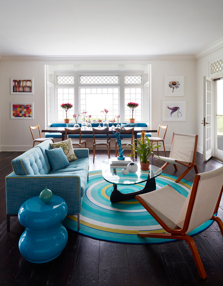 Example of an eclectic dark wood floor and brown floor living room design in New York with white walls