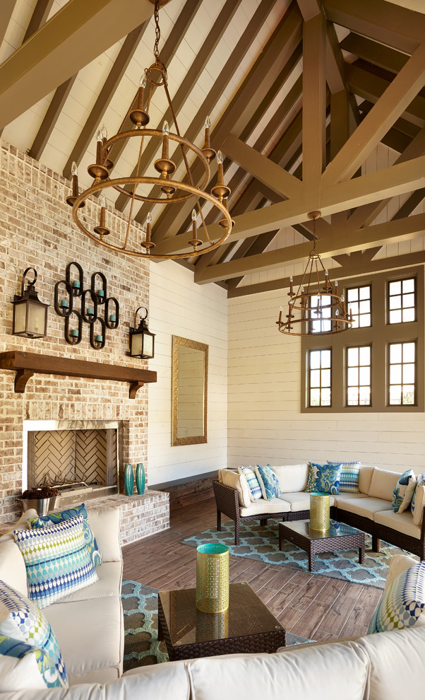 Elegant enclosed dark wood floor living room photo in Atlanta with beige walls, a standard fireplace and a brick fireplace