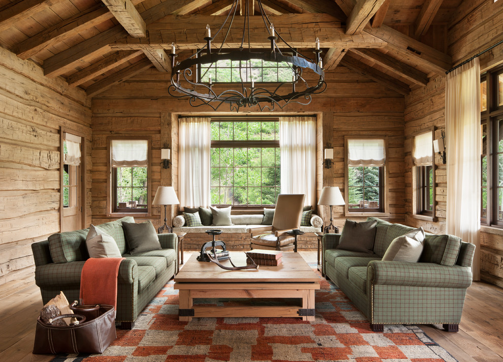 Large mountain style formal and enclosed light wood floor living room photo in Denver with brown walls