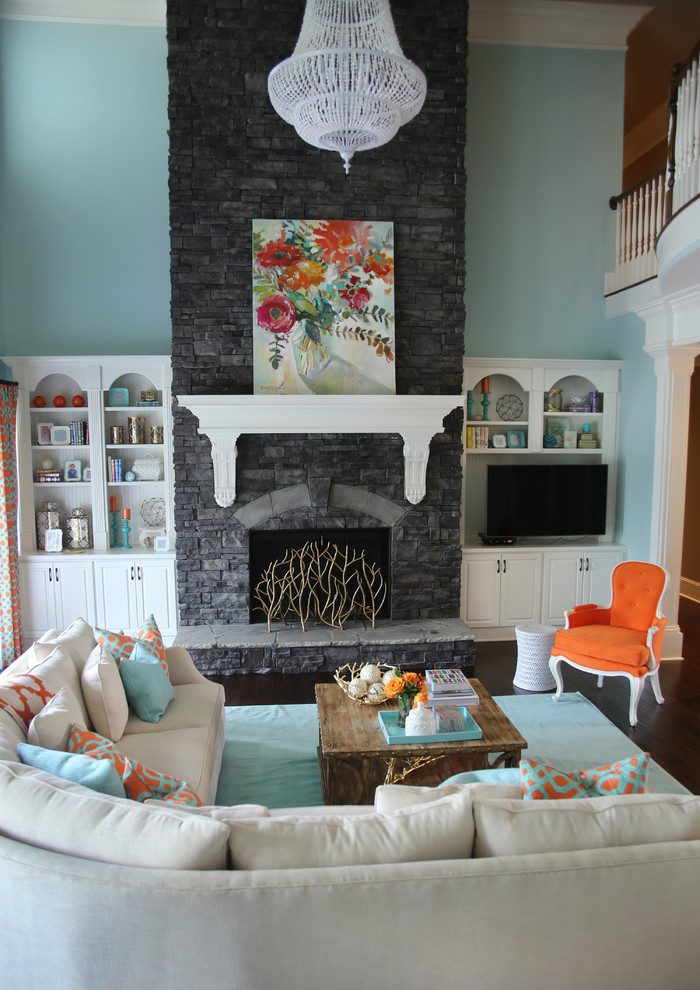Inspiration for a transitional formal dark wood floor living room remodel in Atlanta with blue walls, a standard fireplace, a stone fireplace and a tv stand