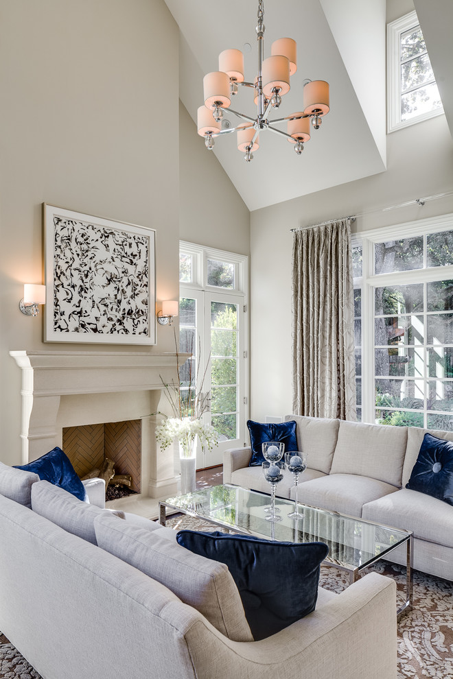Living room - traditional formal living room idea in San Francisco with beige walls, a standard fireplace and no tv