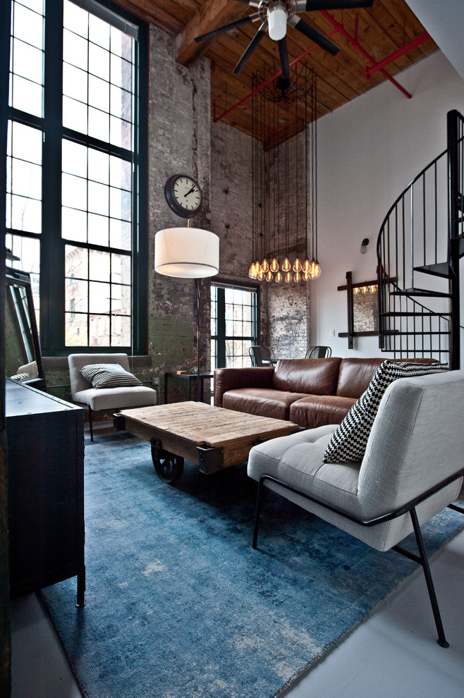 Mid-sized urban open concept concrete floor and gray floor living room photo in Atlanta with white walls, no fireplace and a tv stand