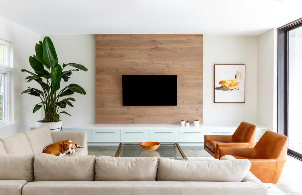 Large trendy formal and enclosed concrete floor and brown floor living room photo in Jacksonville with white walls and a wall-mounted tv