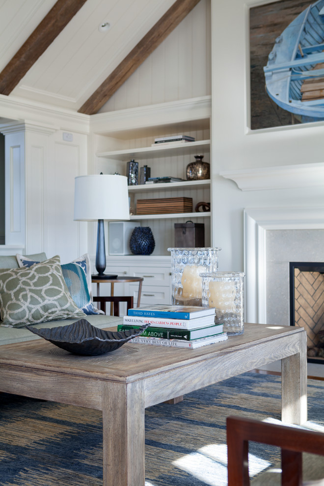 Example of a large coastal formal and open concept medium tone wood floor living room design in Boston with white walls, a standard fireplace and a stone fireplace