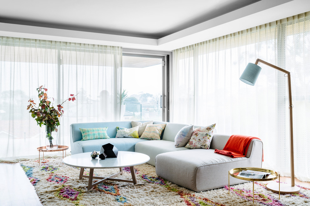 Inspiration for a contemporary living room in Perth with white walls.