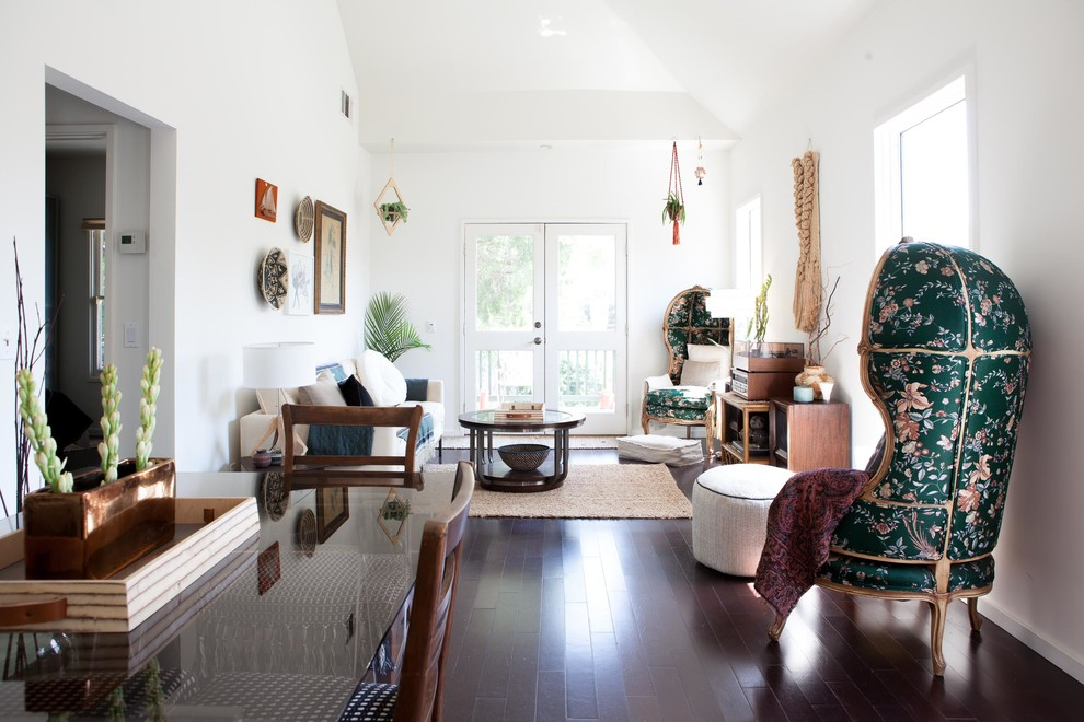 Living room - mid-sized mid-century modern enclosed dark wood floor and brown floor living room idea in Los Angeles with white walls, no fireplace and no tv