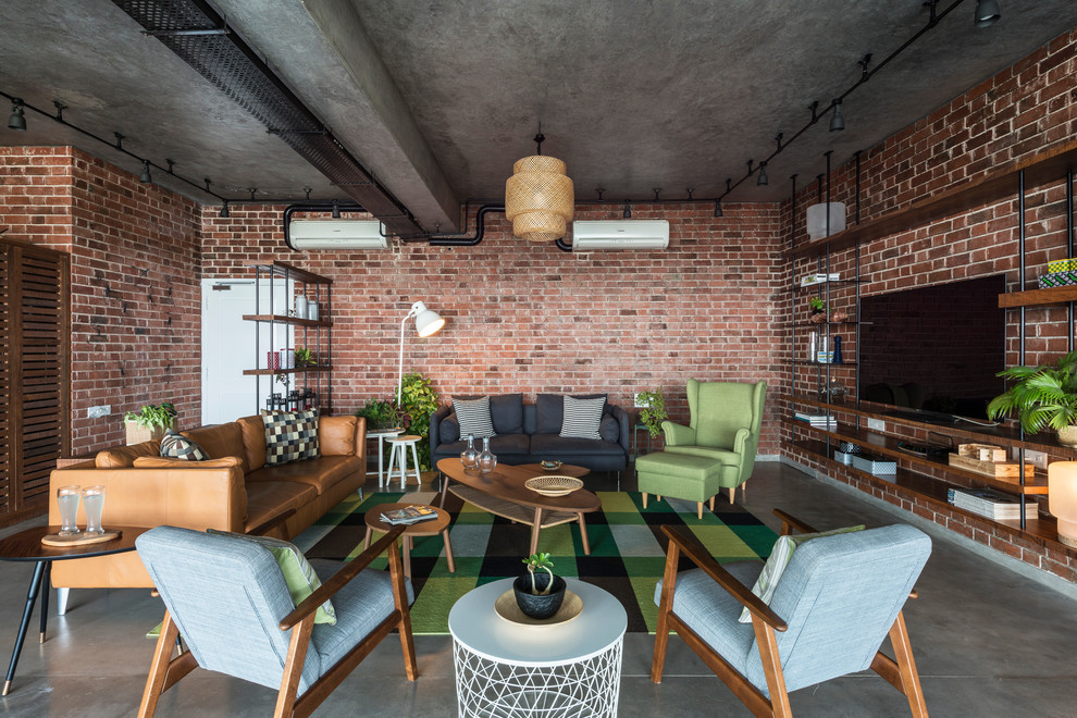 Family room - industrial open concept concrete floor and gray floor family room idea in Ahmedabad with red walls, no fireplace and a wall-mounted tv