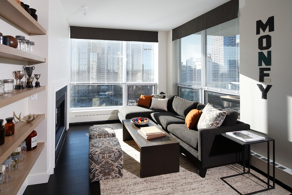 Living room - contemporary dark wood floor and black floor living room idea in Calgary with a standard fireplace