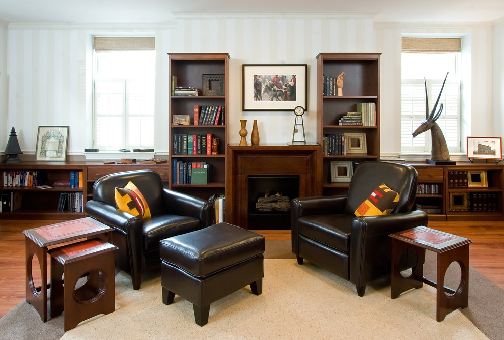 Trendy living room photo in Boston with a wood fireplace surround