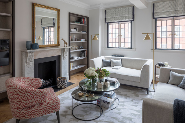 Inspiration for a mid-sized transitional enclosed and formal beige floor and medium tone wood floor living room remodel in London with gray walls, a standard fireplace and a stone fireplace