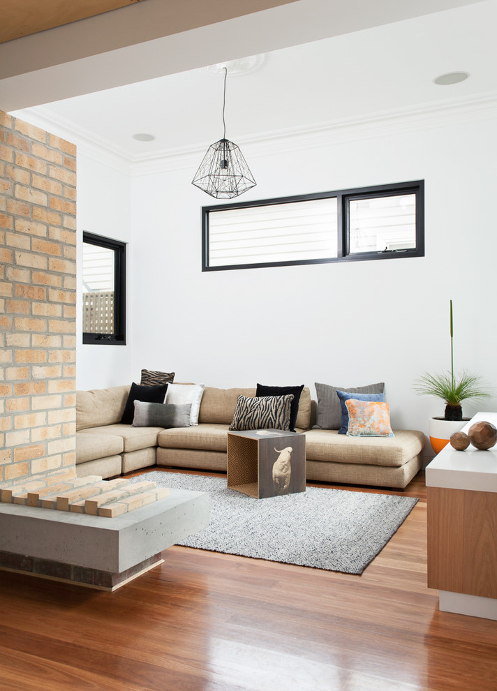 Example of a trendy open concept medium tone wood floor living room design in Melbourne with white walls